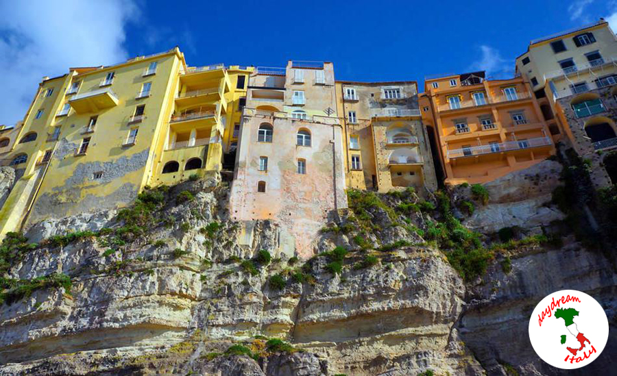 tropea buildings tower over the rock cliff